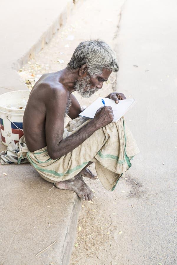 Editorial illustrative image. Portrait of smiling sad senior Indian man. Illustrative image. Pondicherry, Tamil Nadu, India - April 14, 2014. Portrait of senior stock photos