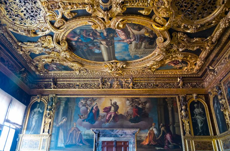 Editorial. May, 2019. Venice, Italy. Fragment of the interior painting and decoration of the ceiling and walls in the Doge`s stock photography