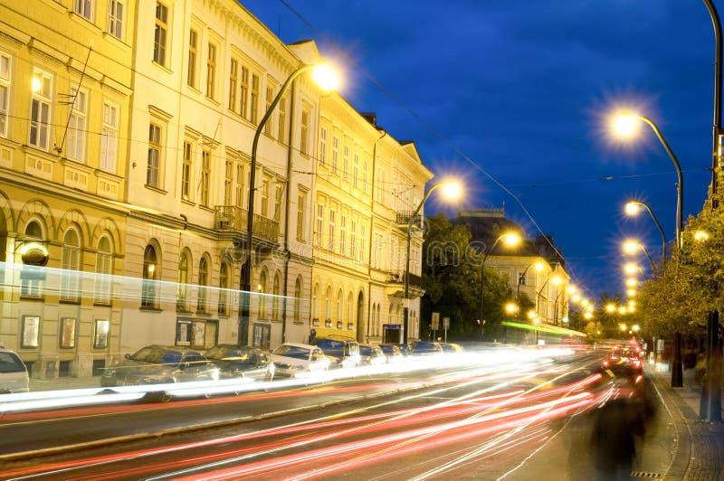 Editorial night scene boulevard car tram light streaks historic