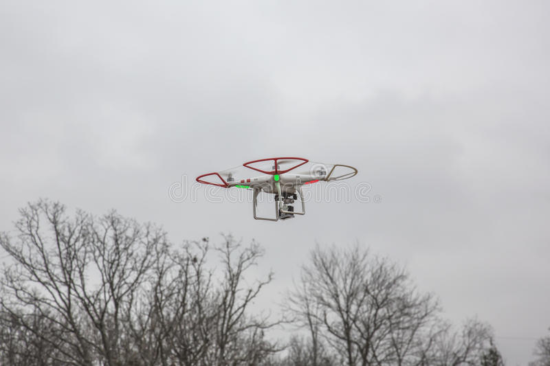 Editorial photo of a DJI Phantom drone in flight with a mounted GoPro Hero3 Black Edition stock images