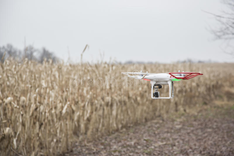 Editorial photo of a DJI Phantom drone in flight with a mounted GoPro Hero3 Black Edition stock photo