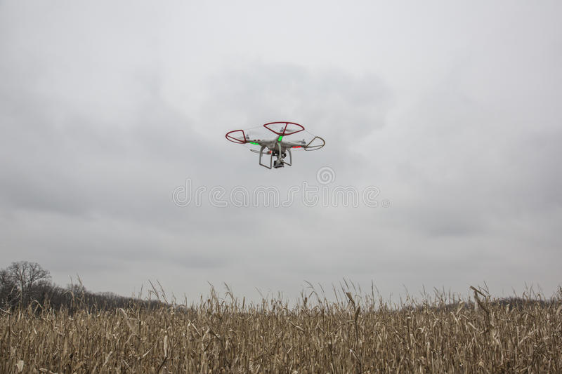 Editorial photo of a DJI Phantom drone in flight with a mounted GoPro Hero3 Black Edition stock photos