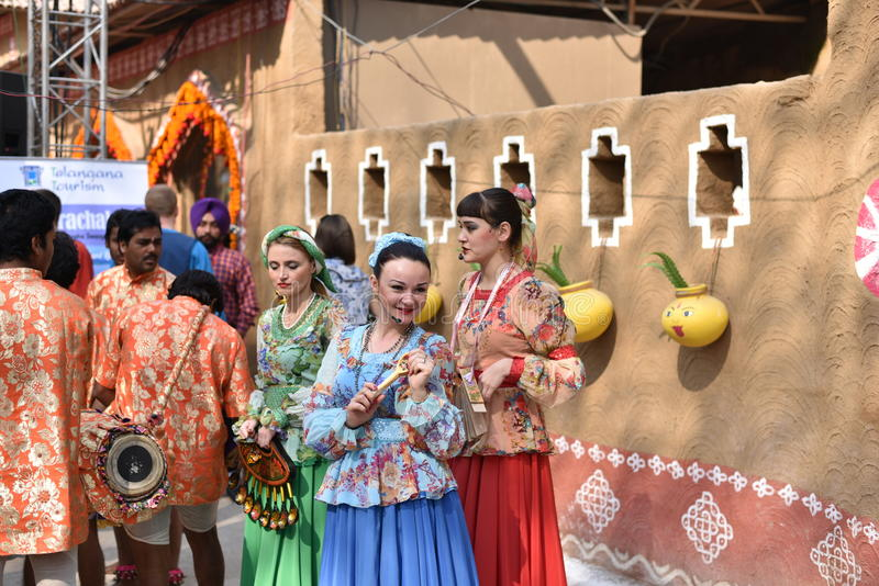 Editorial: Surajkund, Haryana, India:Feb 06th, 2016:Spirit of Carnival in 30th International crafts Carnival. Artists in traditional dresses and enjoying the stock photo