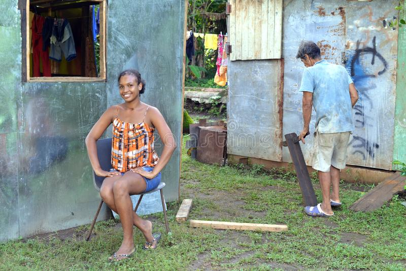 Editorial woman man zinc house Corn Island Nicaragua royalty free stock photography
