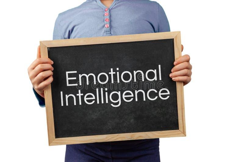 Edizione emozionale di intelligenza rappresentata con la lavagna della tenuta del bambino con testo fotografia stock