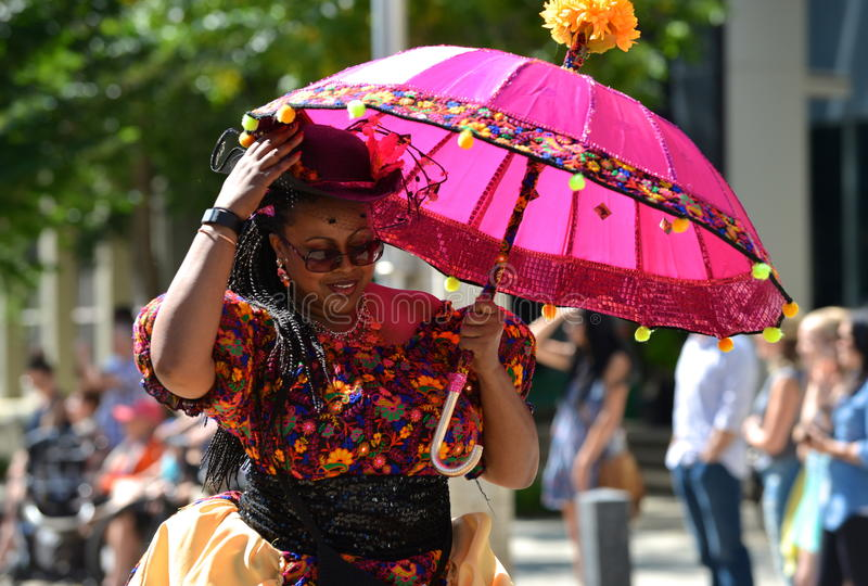 Edmonton, Canada-August 6, 2016: A woman performs at Edmonton`s Cariwest festival. Women performing at Edmonton`s Cariwest festival royalty free stock photography