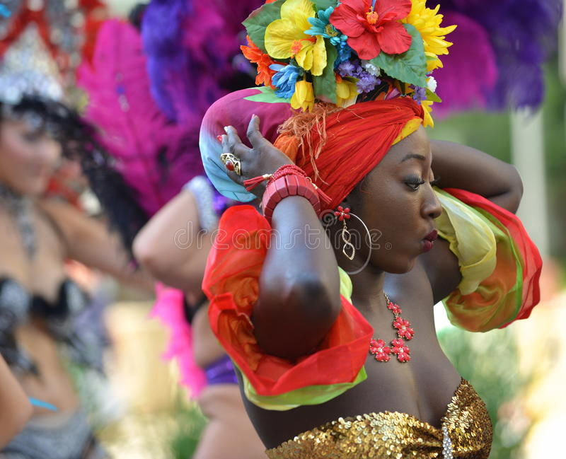 Edmonton, Canada-August 6, 2016: A woman performs at Edmonton`s Cariwest festival. Women performing at Edmonton`s Cariwest festival stock image