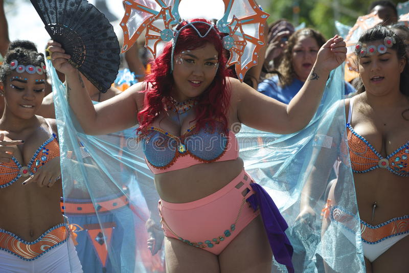 Edmonton, Canada-August 6, 2016: A woman performs at Edmonton`s Cariwest festival. Women performing at Edmonton`s Cariwest festival royalty free stock image