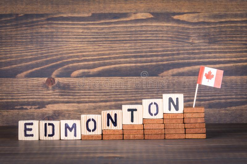 Edmonton, Canada. Politics, economic and immigration concept. Wooden letters and flag on the office desk royalty free stock image