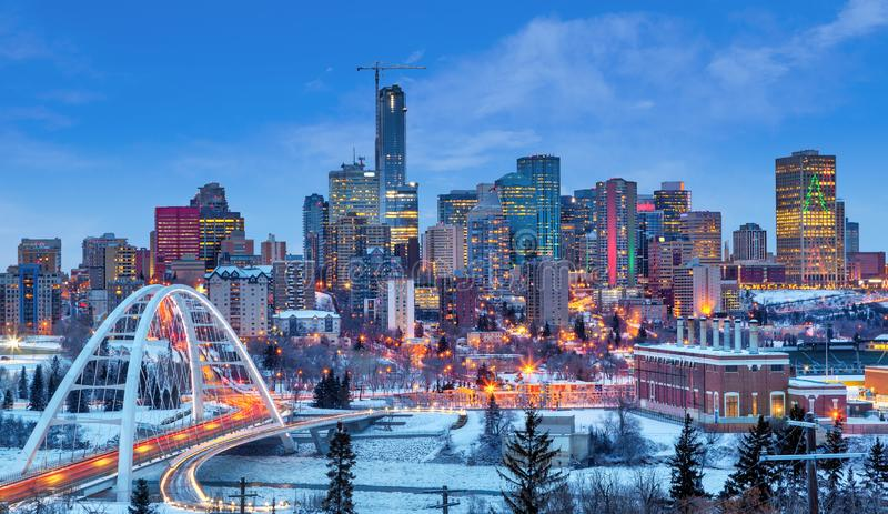 Edmonton Downtown Skyline Just After Sunset in the Winter. Edmonton downtown Winter skyline just after sunset at the blue hour showing Walterdale Bridge across royalty free stock images