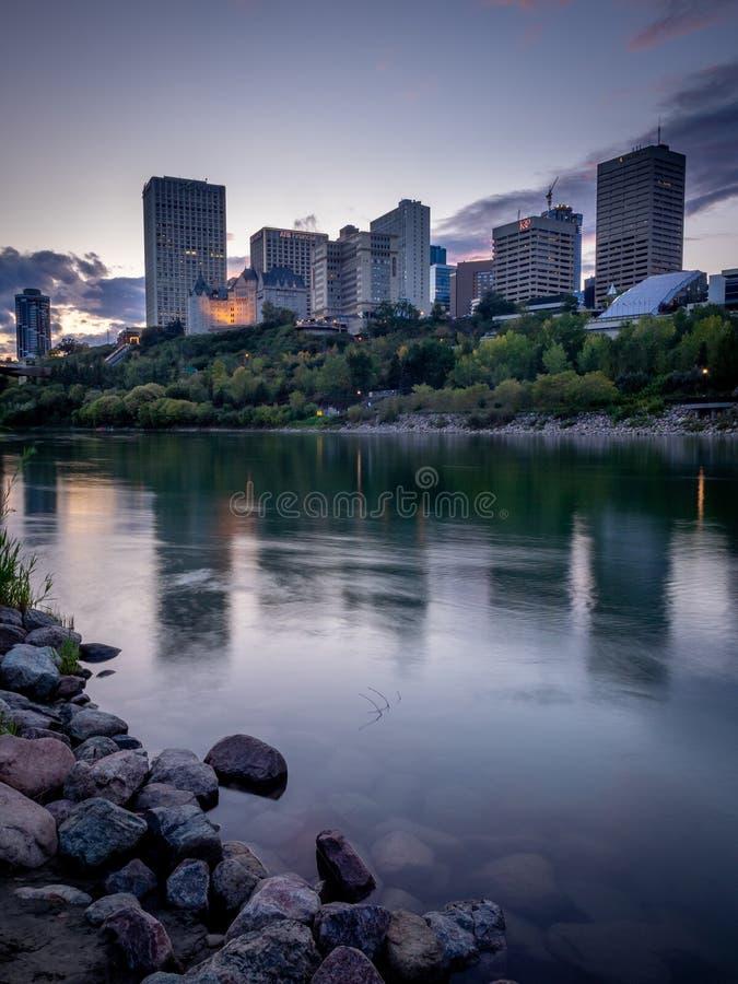Edmonton`s skyline. At dusk in Edmonton, Alberta. The Saskatchewan River is in the foreground royalty free stock image