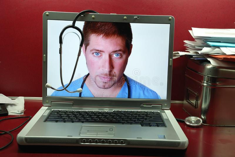 Edoctor in Laptop stock afbeeldingen