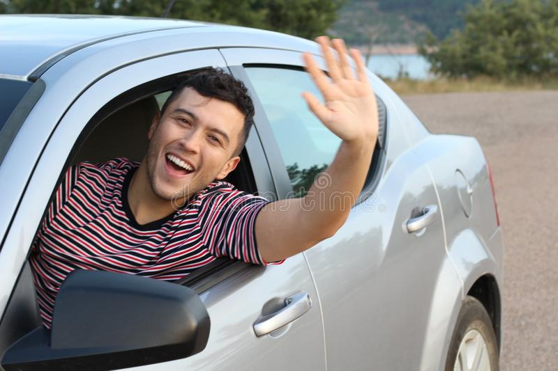 Educated driver saluting a friend.  stock photos