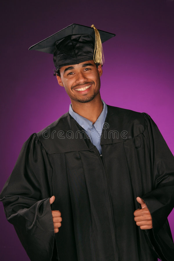Educated graduate. Celebrating his achievement this educated graduate puts his thumbs up stock images