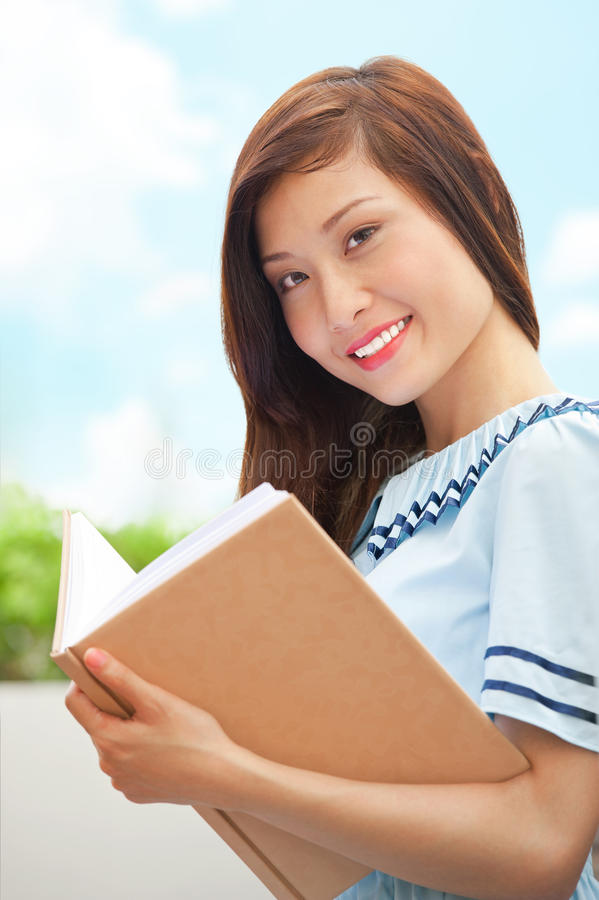 Download Educated student stock photo. Image of holding, brunette - 25119088