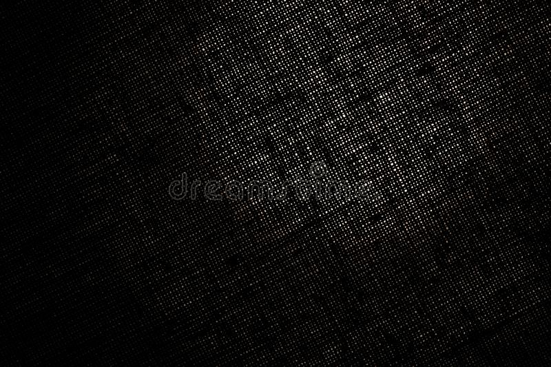 Educated texture of the cloth ill light spot, the abstraction of a fabric. Close-up stock photos