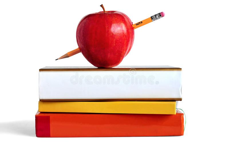 Education. Pile of books, pencil, and an apple representing education or school stock photo