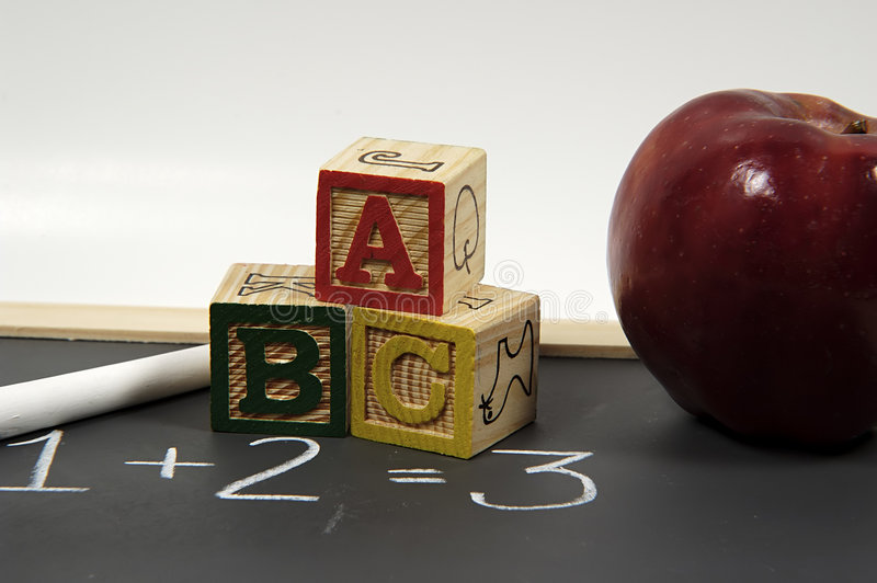 Education. Photo of Chalk, Chalkboard, Blocks and Apple. Preschool Classroom Related Objects stock photo