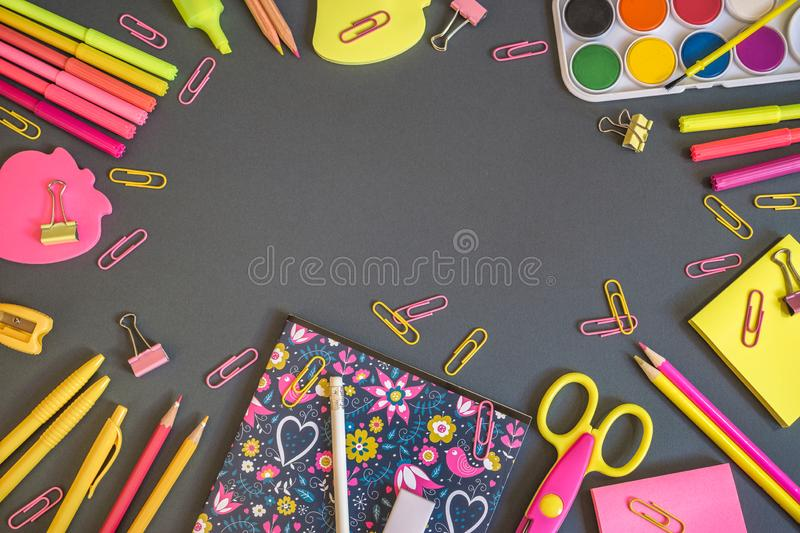 Education or back to school background. Colorful school supplies on dark background, back to school concept. Top view with copy space stock photo