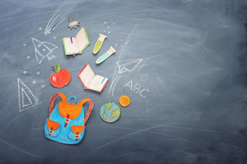 Education and back to school concept. shapes cut from paper and painted of backpack, books, chemistry flask and apple over royalty free stock images