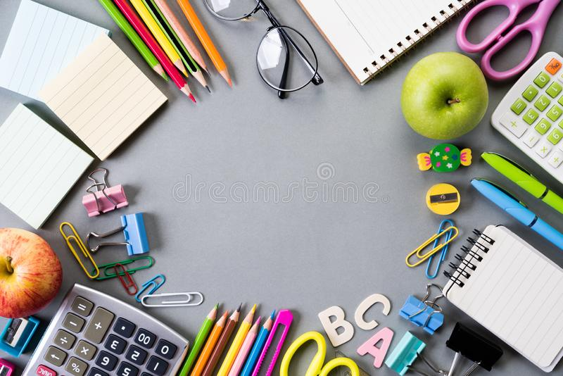 Education or back to school Concept. Top view of Colorful school supplies with books, color pencils, calculator, pen cutter clips royalty free stock images