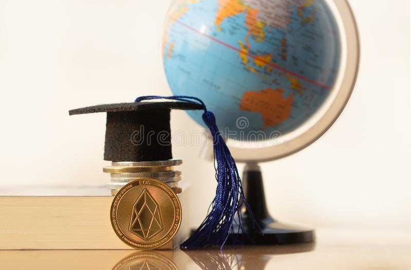 Education in blockchain and EOS coin. International Graduation cap on Bitcoin Cryptocurrency. royalty free stock images