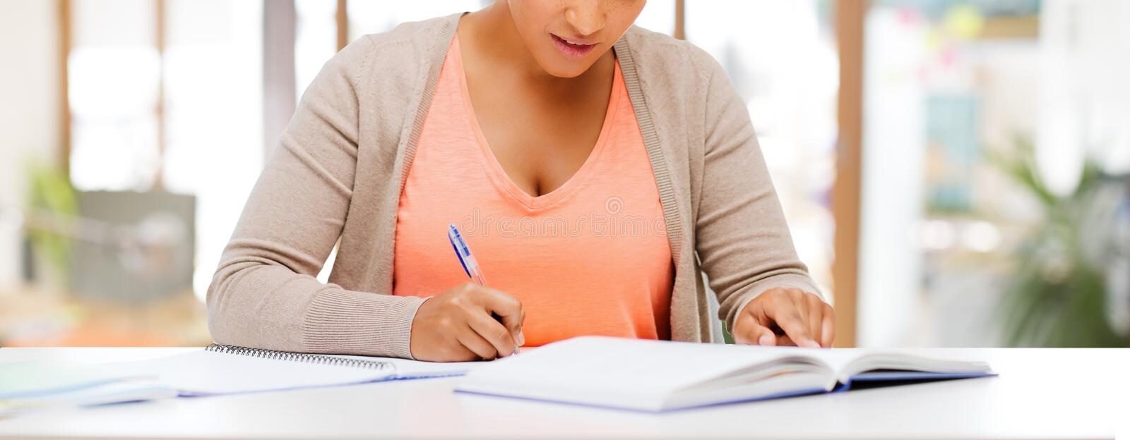 African american female student with notebook stock photography