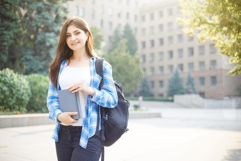 Education, campus and student concept. Smiling female student wi royalty free stock photography