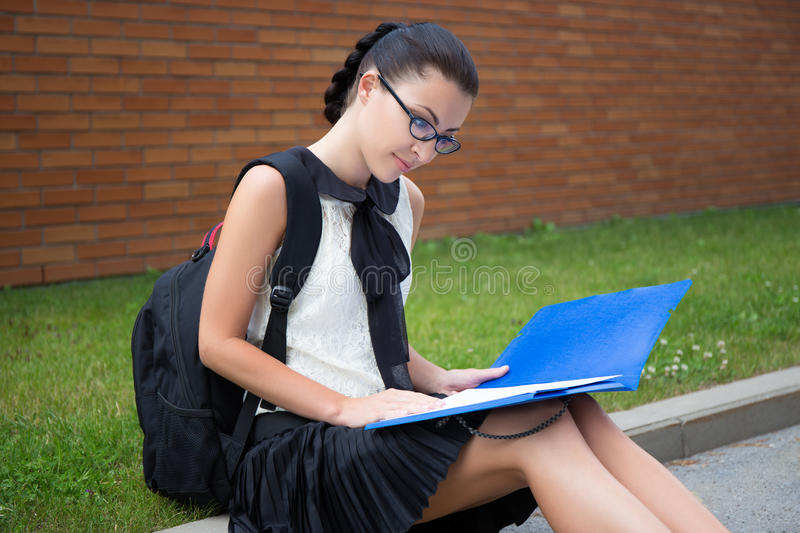 Education concept - beautiful school girl or student reading som stock photos