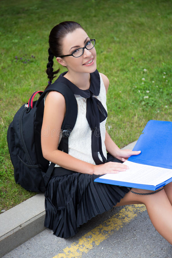 Education concept - beautiful school girl or student reading som stock photography