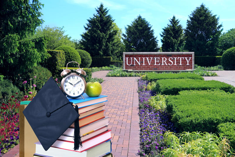 Education concept. With book and university campus stock photography