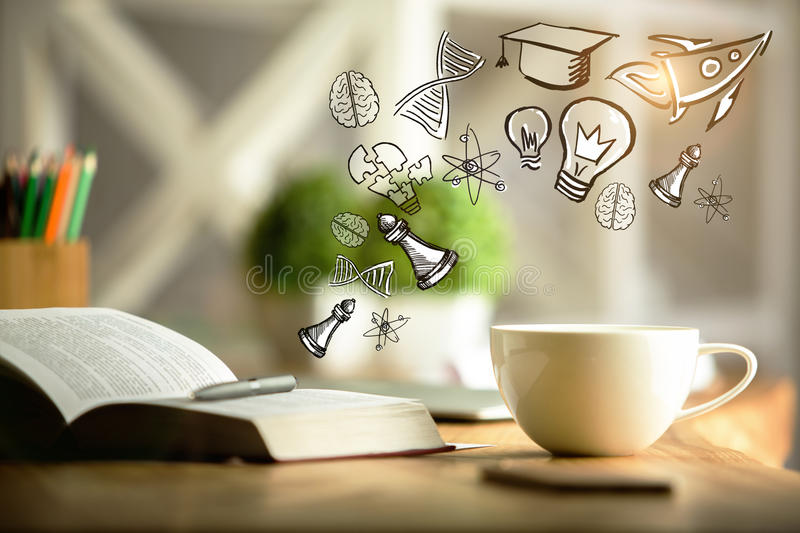 Education concept. Close up of open book and coffee cup on desktop with abstract sketch. Education concept royalty free stock images