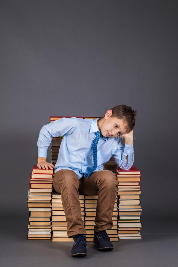 Education concept. Dreaming boy the reader sitting on a throne stock photos