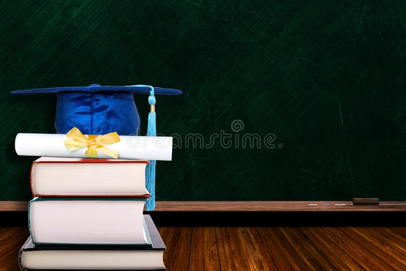 Education Concept With Graduation Hat and Diploma on Books and Blackboard Background royalty free stock image