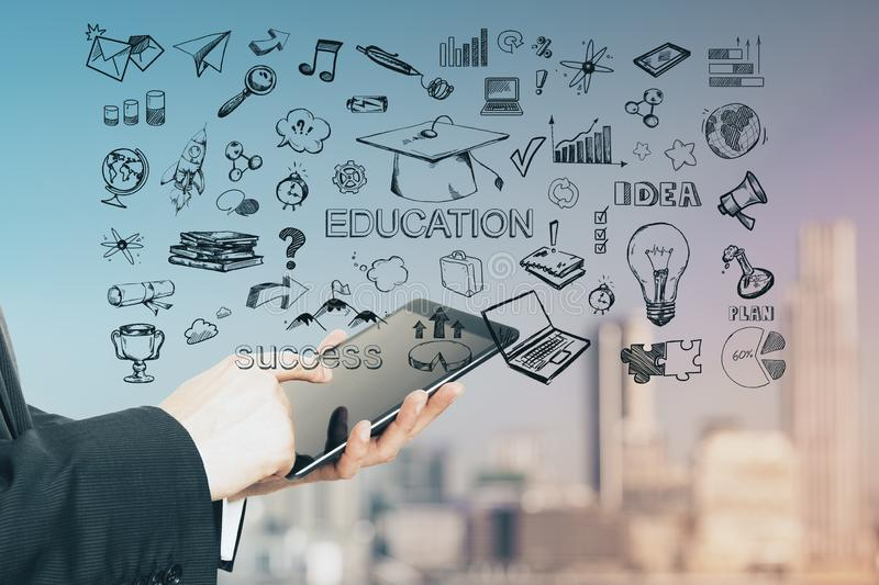 Education concept with hand drawn symbols and words and man hands with digital tablet stock illustration