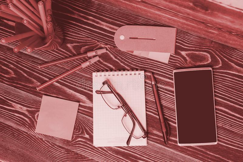 Education Concept. School and Office Supplies with Smartphone on Wooden Background. stock images