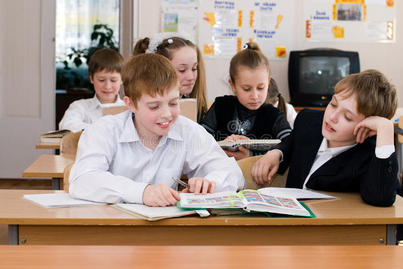 Education concept - School Students at the class royalty free stock images