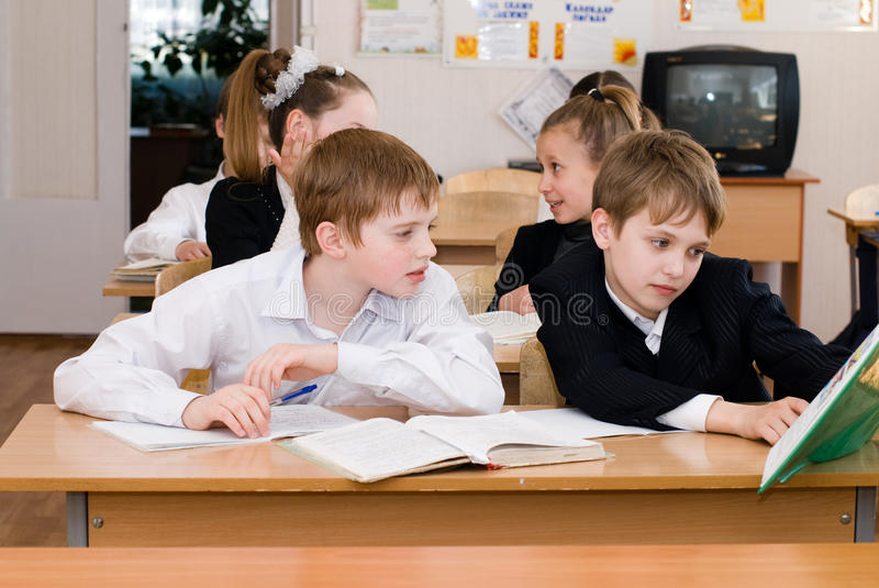 Education concept - School Students at the class royalty free stock photography