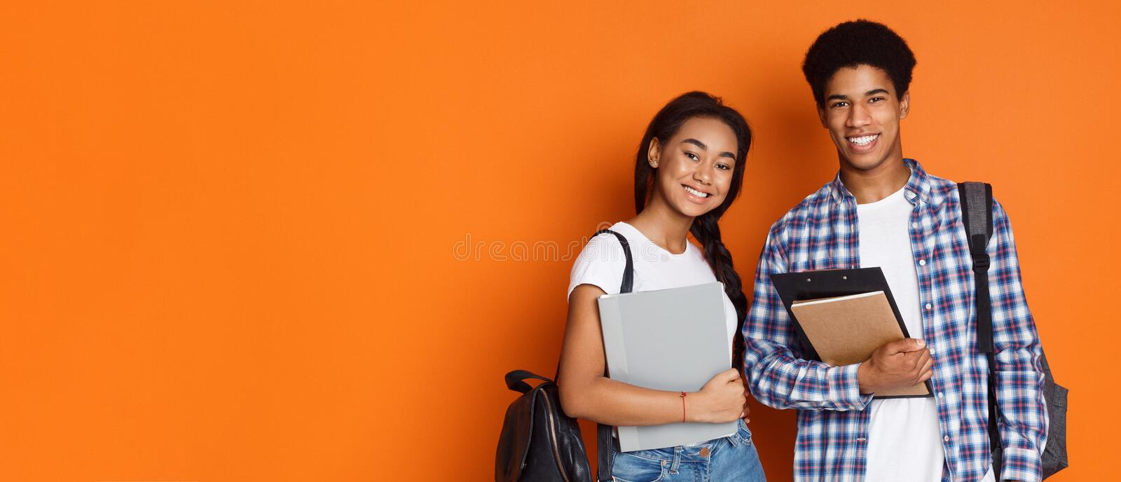 Education concept. Students holding exercise books, empty space royalty free stock photo