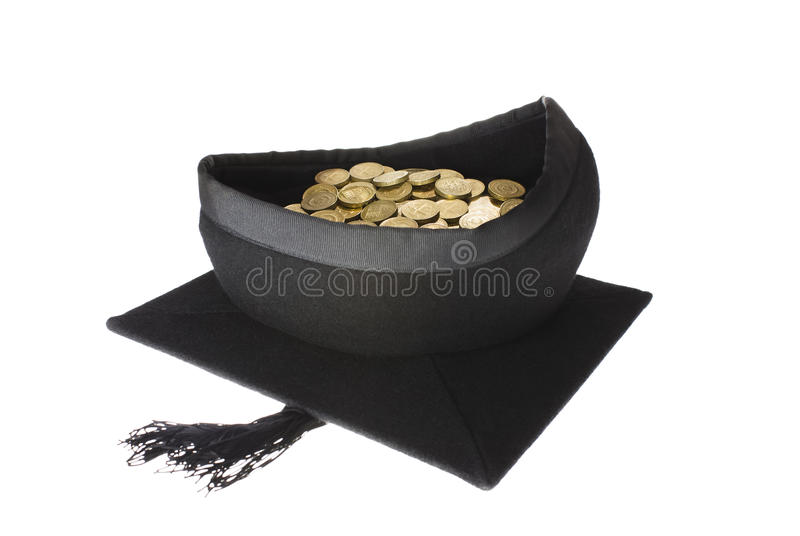 Education Costs - Mortar Board Graduation Cap Full. A student mortarboard graduation cap filled with gold coins indicating the cost of education and research royalty free stock image