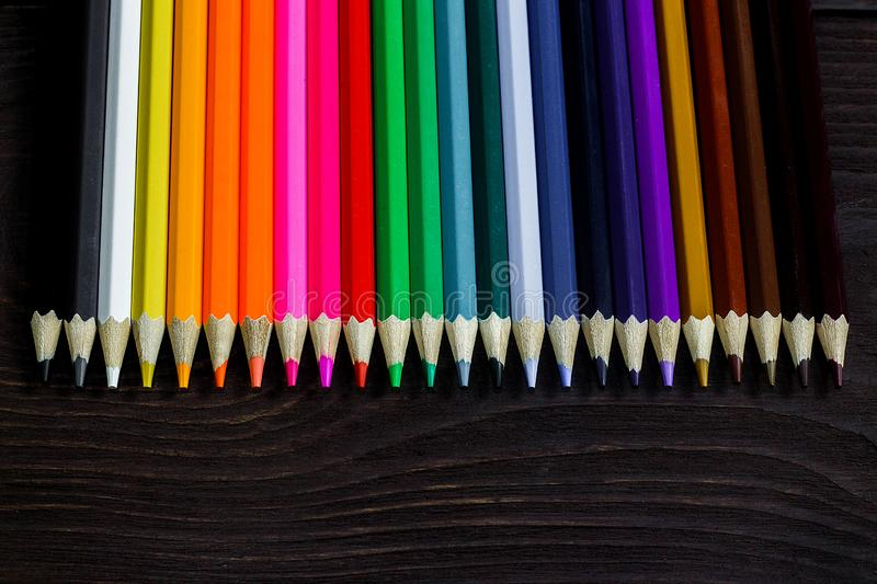 Education and creativity concept: colored pencils on wooden background.  royalty free stock photos