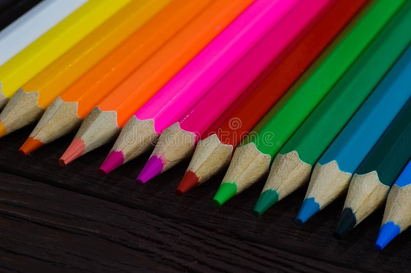 Education and creativity concept: colored pencils on wooden background.  royalty free stock photography