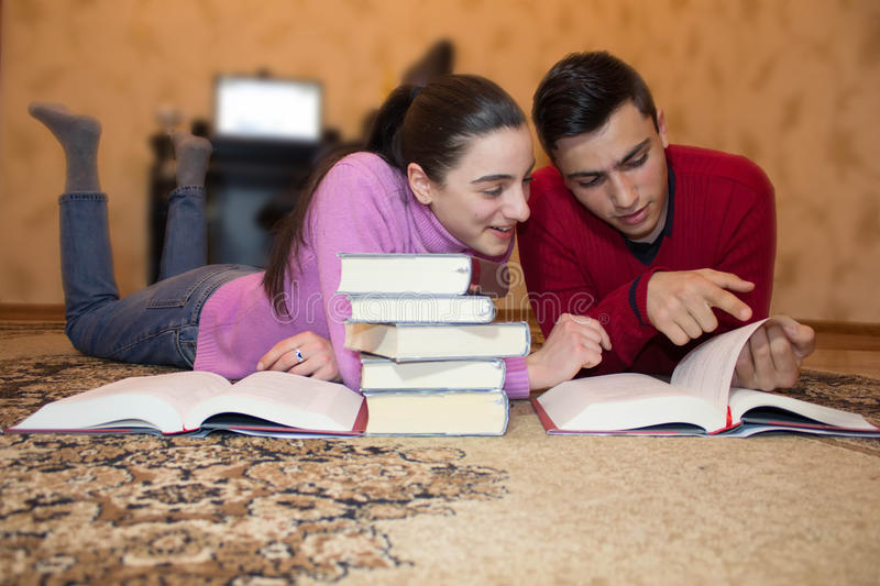 Education and development of life skills. Children read books royalty free stock photography