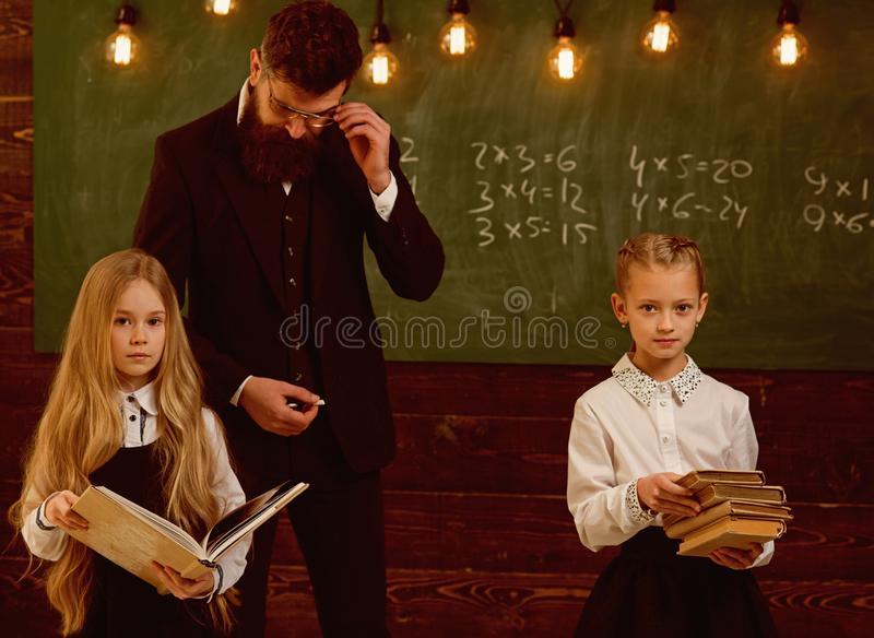 Education. education process at school lesson, teacher gives education to little girls. improving yourself through stock photo
