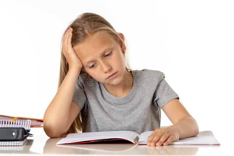 Young school student girl looking unhappy and tired in education concept stock images