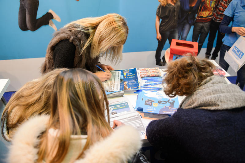 Education Fair to choose career path and vocational counseling. STRASBOURG, FRANCE - FEB 4, 2016: Children and teens of all ages attending annual Education Fair royalty free stock image