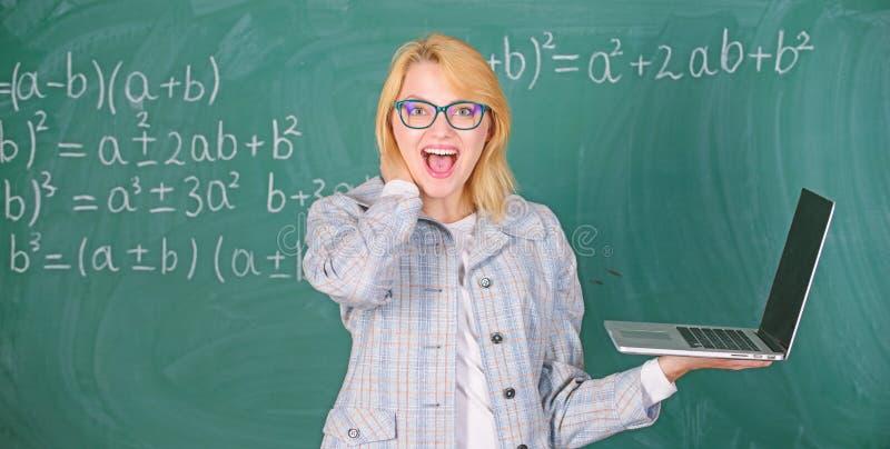 Education is fun. Woman teacher wear eyeglasses holds laptop surfing internet. Digital technologies concept. Educator royalty free stock images