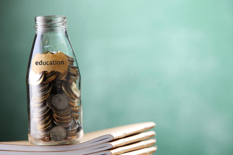 Education fund. Saving jar with coin for eduction royalty free stock photos