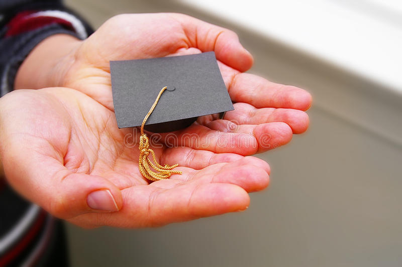 Education in hands stock photo