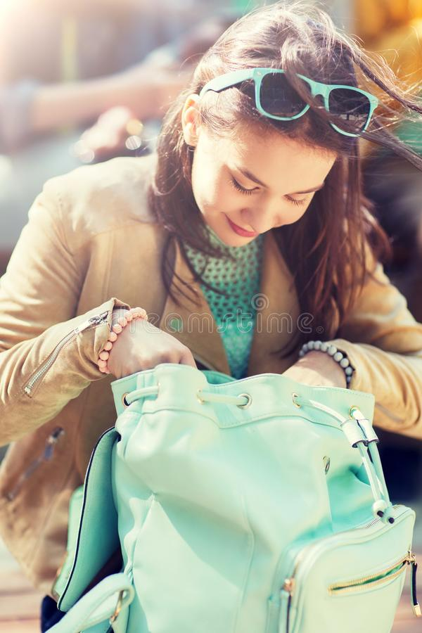High school student girl with backpack outdoors stock photography